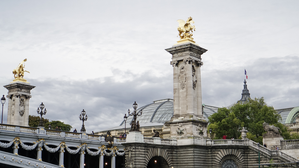 The Pont Alexandre III is described as the most extravagant bridge in the city. In the background is the Grand Palais.